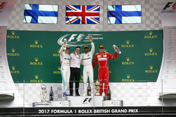 Second place Valtteri Bottas, Mercedes AMG F1, Peter Bonnington, Race Engineer, Mercedes AM, Race winner Third place Lewis Hamilton, Mercedes AMG F1 Kimi Raikkonen, Ferrari, on the podium