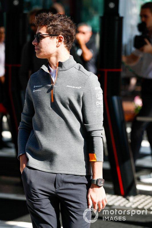 Lando Norris, McLaren, arrives in the paddock