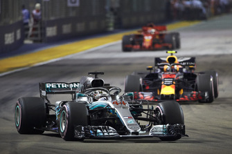 Lewis Hamilton, Mercedes AMG F1 W09 EQ Power+, leads Max Verstappen, Red Bull Racing RB14