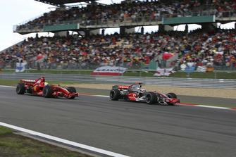 Fernando Alonso, McLaren MP4-22 Mercedes, 1st position, attempts to pass Felipe Massa, Ferrari F2007, 2nd position, for the lead