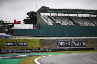 Heineken and Johnnie Walker branding on a grandstand and trackside signage