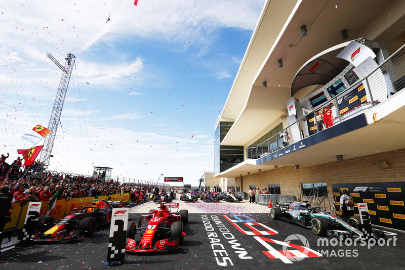 Kimi Raikkonen, Ferrari SF71H, celebrates on the podium with Max Verstappen, Red Bull Racing, and Lewis Hamilton, Mercedes AMG F1 W09 EQ Power+, after winning the race.