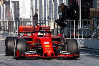 Sebastian Vettel, Ferrari SF90, passes the McLaren pit wall and Pat Fry