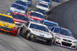 Joey Logano, Team Penske Ford, Landon Cassill, Front Row Motorsports, Ford Fusion and Chris Buescher, JTG Daugherty Racing Chevrolet