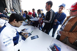 Lance Stroll, Williams, signs autographs for fans, alongside Felipe Massa, Williams