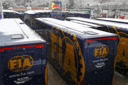 Snow falls over the paddock