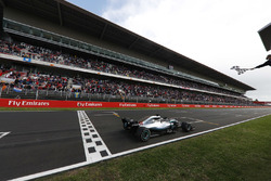 Lewis Hamilton, Mercedes AMG F1 W09, takes the chequered flag at the finish