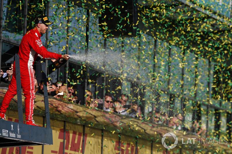 Sebastian Vettel, Ferrari, 1st position, sprays Champagne from the podium