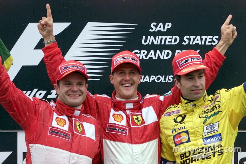 Podio: segundo lugar Rubens Barrichello, Ferrari; ganador de la carrera Michael Schumacher, Ferrari; y tercer lugar Heinz Harald Frentzen, Jordan