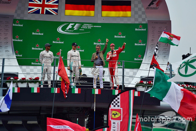 The podium (L to R): second place Lewis Hamilton, Mercedes AMG F1; Race winner Nico Rosberg, Mercede