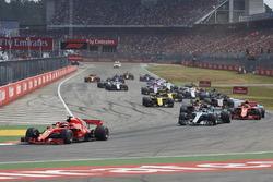 Sebastian Vettel, Ferrari SF71H, leads Valtteri Bottas, Mercedes AMG F1 W09, Kimi Raikkonen, Ferrari SF71H, Max Verstappen, Red Bull Racing RB14, Kevin Magnussen, Haas F1 Team VF-18, Nico Hulkenberg, Renault Sport F1 Team R.S. 18, and the rest of the field at the start