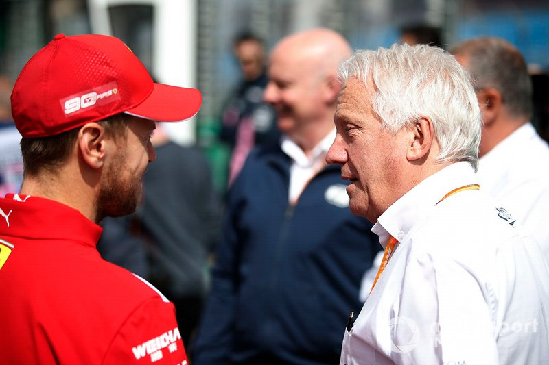 Sebastian Vettel, Ferrari, with Charlie Whiting, Race Director, FIA