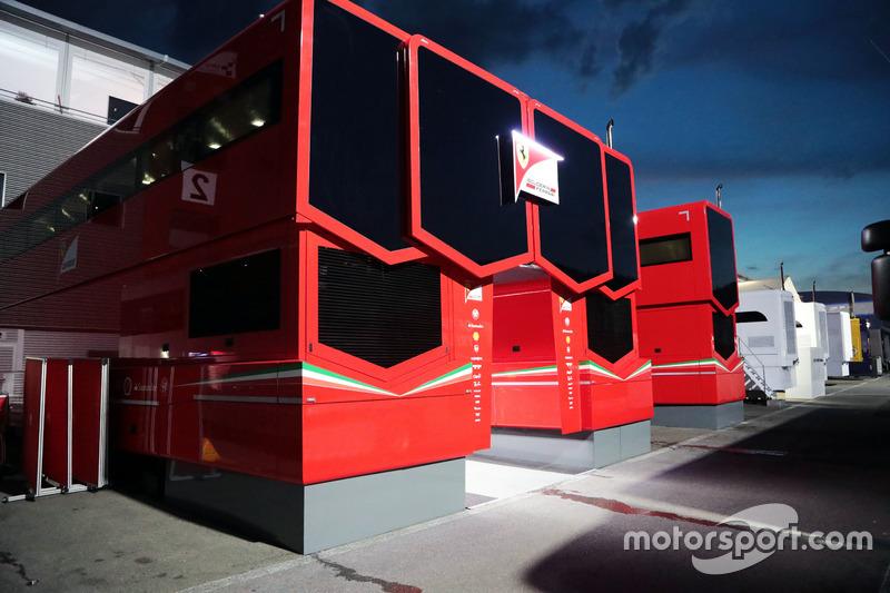 Ferrari trucks in the paddock at night