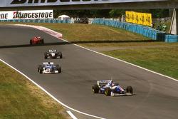 Jacques Villeneuve, Williams Renault, Damon Hill, Arrows A18 Yamaha, Mika Hakkinen, McLaren MP4/12 Mercedes and Eddie Irvine, Ferrari F310B