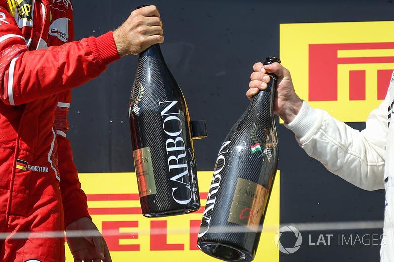 Подіум: переможець Себастьян Феттель, Ferrari, Валттері Боттас, Mercedes AMG F1