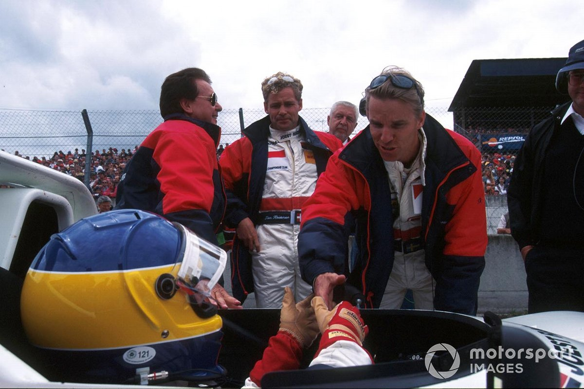 Johansson wishes longtime buddy and polesitter Michele good luck before the start of their ultimately victorious run in the 1997 Le Mans 24 Hours. Their co-driver and eventual LM24 legend Tom Kristensen looks on. Reinhold Joest is on the left.
