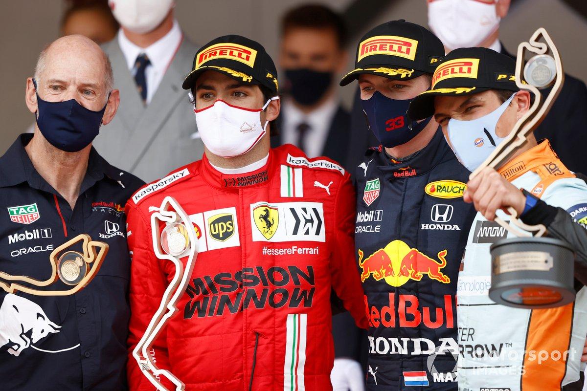 Adrian Newey, Chief Technical Officer, Red Bull Racing, Carlos Sainz Jr., Ferrari, 2nd position, Max Verstappen, Red Bull Racing, 1st position, and Lando Norris, McLaren, 3rd position, on the podium