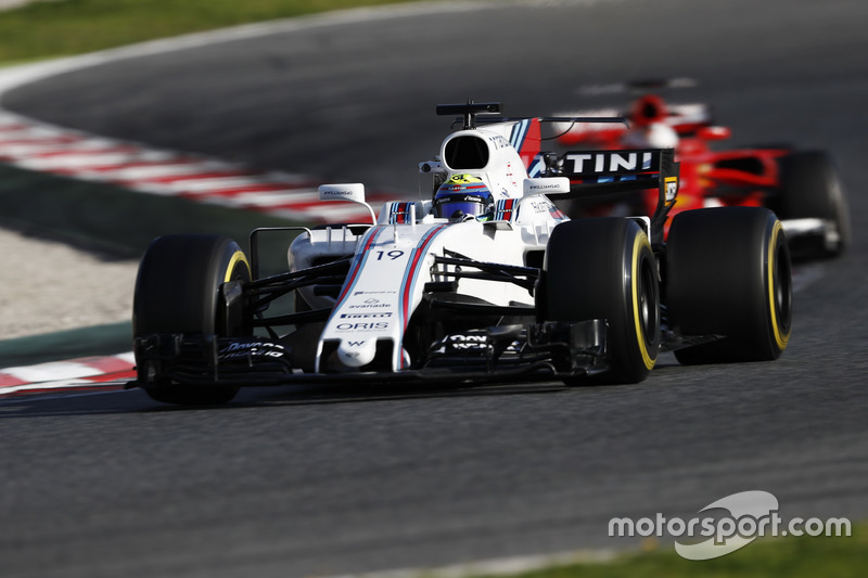 Felipe Massa, Williams FW40, ve Sebastian Vettel, Ferrari SF70H