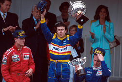 Podium: race winner Olivier Panis, Ligier, second place David Coulthard, McLaren, third place Johnny