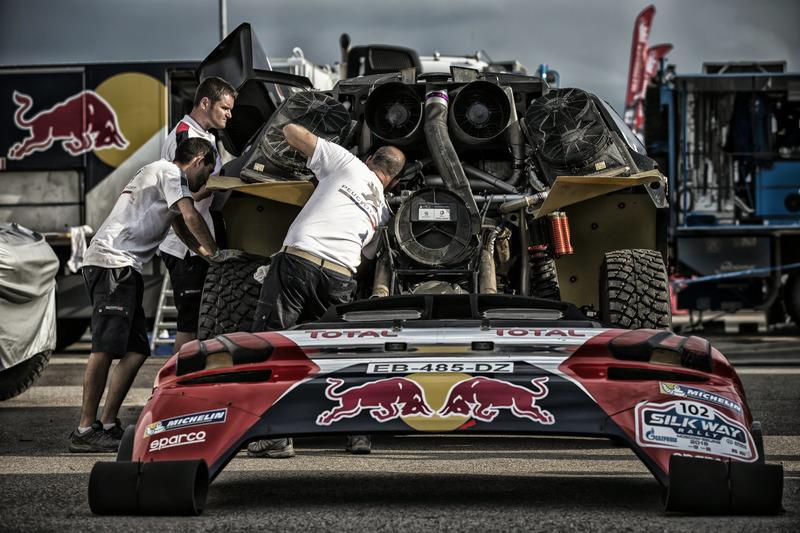 Some Peugeot Sport mechanics checking up the 2008 DKR