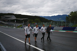 Romain Grosjean, Haas F1 Team, conducts a track walk with colleagues