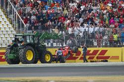 Marshals remove the car of Sebastian Vettel, Ferrari SF71H