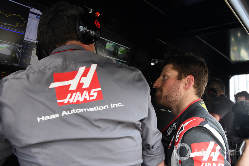 Race retiree Romain Grosjean, Haas F1 and Guenther Steiner, Team Prinicipal, Haas F1 Team