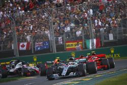 Lewis Hamilton, Mercedes AMG F1 W09, leads Kimi Raikkonen, Ferrari SF71H, Sebastian Vettel, Ferrari SF71H, Kevin Magnussen, Haas F1 Team VF-18 Ferrari, Max Verstappen, Red Bull Racing RB14 Tag Heuer, and the rest of the field at the start