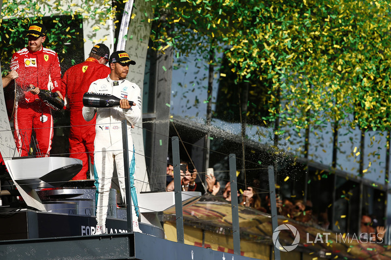 Lewis Hamilton, Mercedes AMG F1, 2nd position, Sebastian Vettel, Ferrari, 1st position, and Kimi Rai