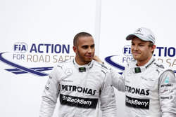 Lewis Hamilton and Nico Rosberg, Mercedes W04, celebrate securing first and second positions