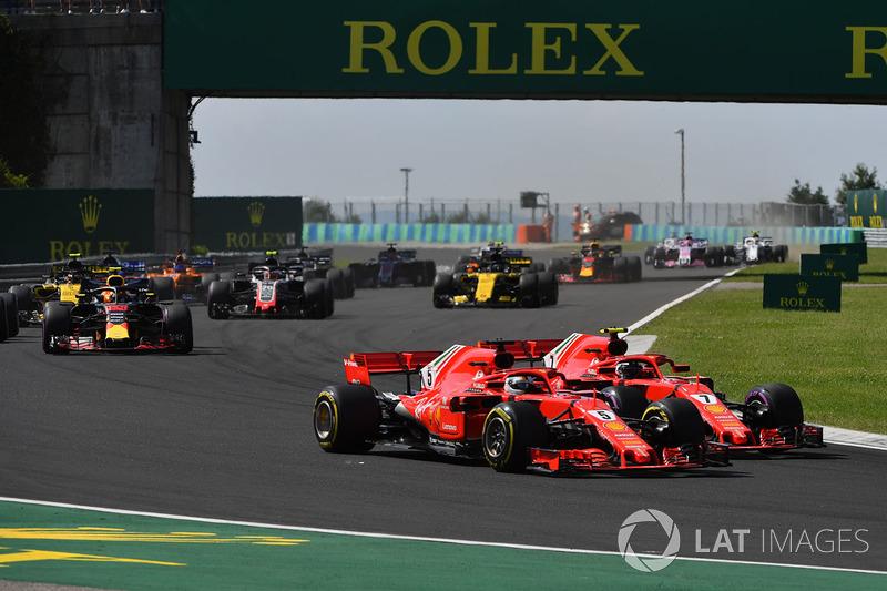 Sebastian Vettel, Ferrari SF71H et Kimi Raikkonen, Ferrari SF71H en lutte