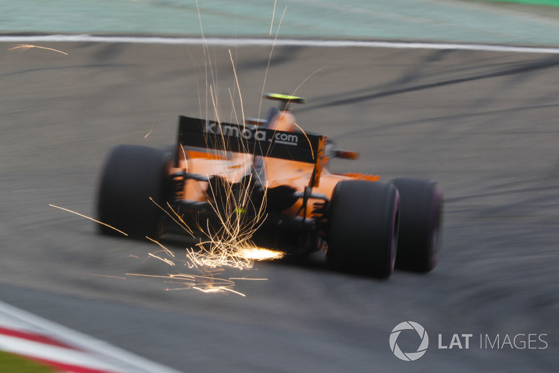 Sparks fly from the car of Stoffel Vandoorne, McLaren MCL33 Renault