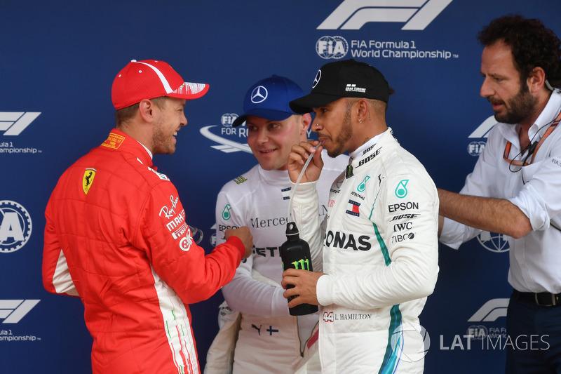 Sebastian Vettel, Valtteri Bottas, Lewis Hamilton y Matteo Bonciani