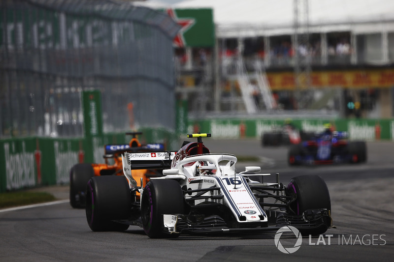 10. Charles Leclerc, Sauber C37, leads Fernando Alonso, McLaren MCL33