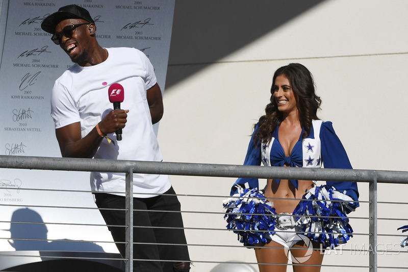 Usain Bolt, grid girl on the podium
