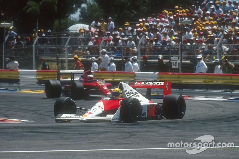 Ayrton Senna, McLaren MP4/5B Honda with Nigel Mansell, Ferrari 641 behind