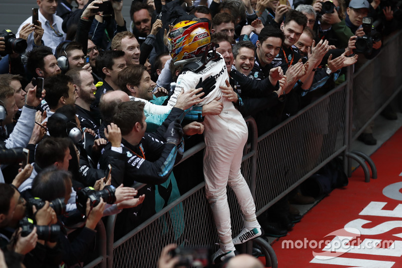 Lewis Hamilton, Mercedes AMG, celebrates on arrival in parc ferme with his team