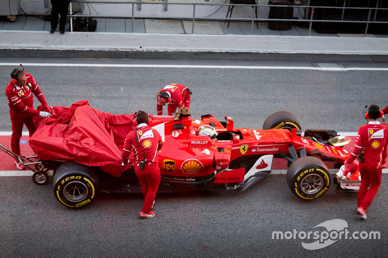 Sebastian Vettel, Ferrari SF70H, stopped in the pitlane