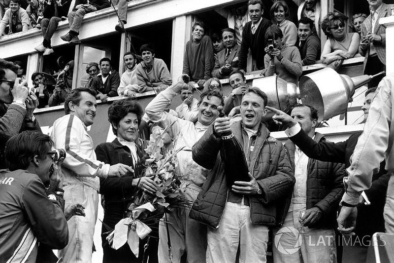 Podium: winners A.J. Foyt, Dan Gurney, second place Ludovico Scarfiotti, Mike Parks. This was the first time champagne was sprayed in celebration on a podium.