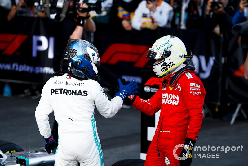Sebastian Vettel, Ferrari and Race Winner Valtteri Bottas, Mercedes AMG F1 celebrate in Parc Ferme