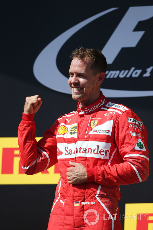 Podium: race winner Sebastian Vettel, Ferrari