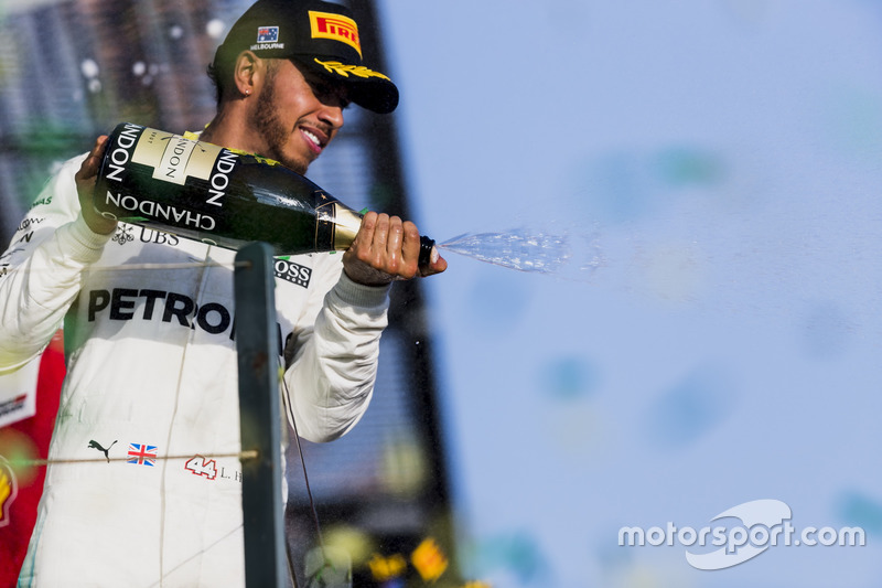 Lewis Hamilton, Mercedes AMG, 2nd Position, sprays Champagne from the podium
