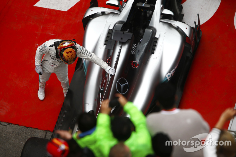 Lewis Hamilton, Mercedes AMG, pats his car in parc ferme after taking victory