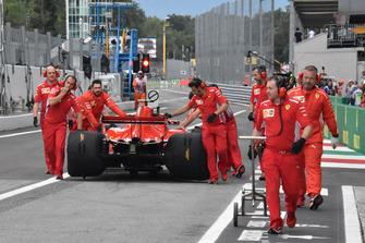 Sebastian Vettel pushed through pitlane