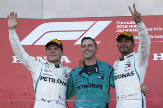 Lewis Hamilton, Mercedes AMG F1, on the podium with Valtteri Bottas, Mercedes AMG F1