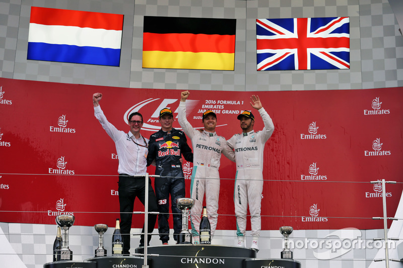 The podium (L to R): Andrew Shovlin, Mercedes AMG F1 Engineer; second place Max Verstappen, Red Bull Racing; Race winner, Nico Rosberg, Mercedes AMG F1; third place Lewis Hamilton, Mercedes AMG F1