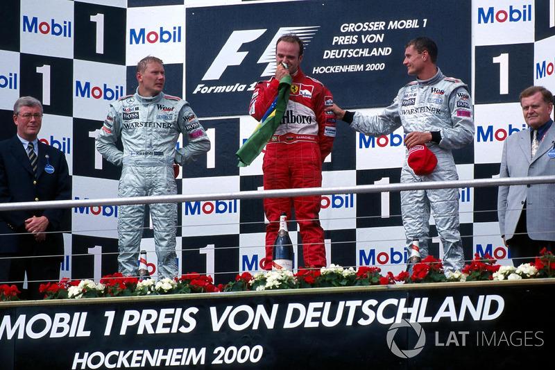Mika Hakkinen, McLaren 2nd, race winner Rubens Barrichello, Ferrari and David Coulthard, McLaren 3rd on the podium