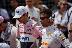 Esteban Ocon, Force India, and Daniel Ricciardo, Red Bull Racing, stand for the national anthem on t