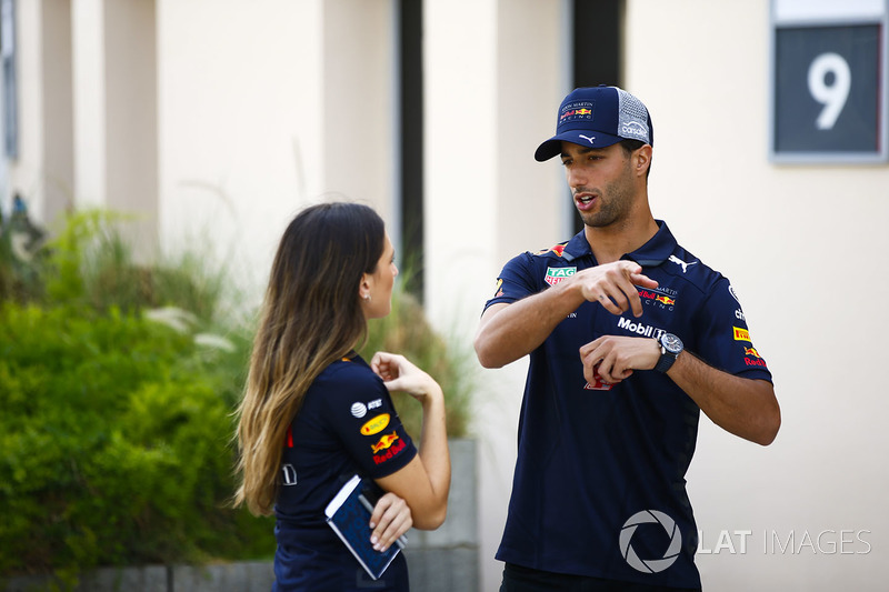 Daniel Ricciardo, Red Bull Racing, talks to a colleague
