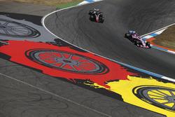 Sergio Perez, Force India VJM11, leads Romain Grosjean, Haas F1 Team VF-18